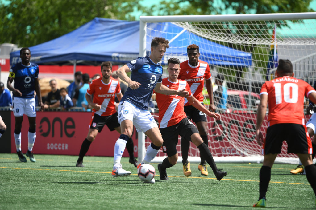 Amer Didic (L), and Dominick Zator (R), battle for the ball. (Photo: FC Edmonton).
