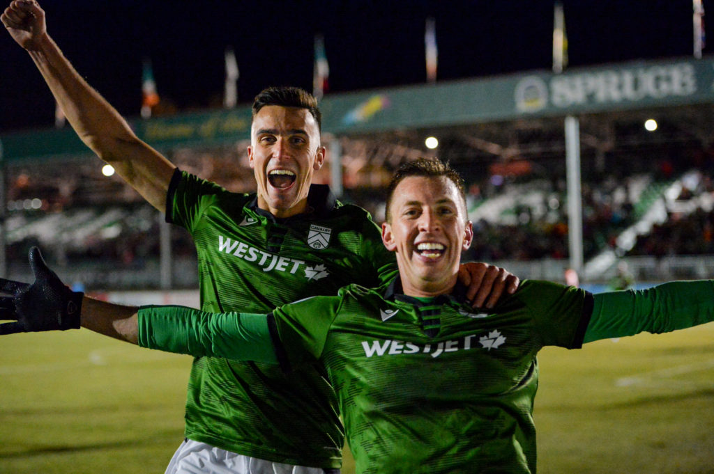 Canadian Premier League - Cavalry FC v Valour FC - Calgary, Alberta, Canada Oct. 2, 2019 Dominik Zator (L) of Cavalry FC and Oliver Minatel Thomal of Cavalry FC celebrate the team's third goal. Mike Sturk/CPL