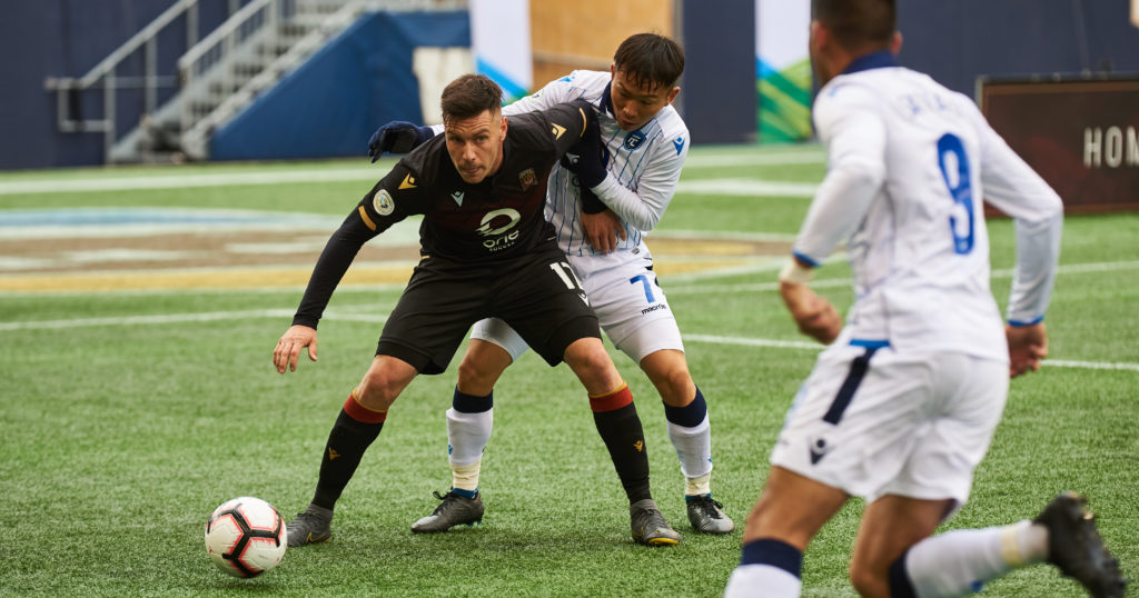 Valour striker Michele Paolucci takes on FC Edmonton's Son Yongchan at IG Field. (Photo: Valour FC).