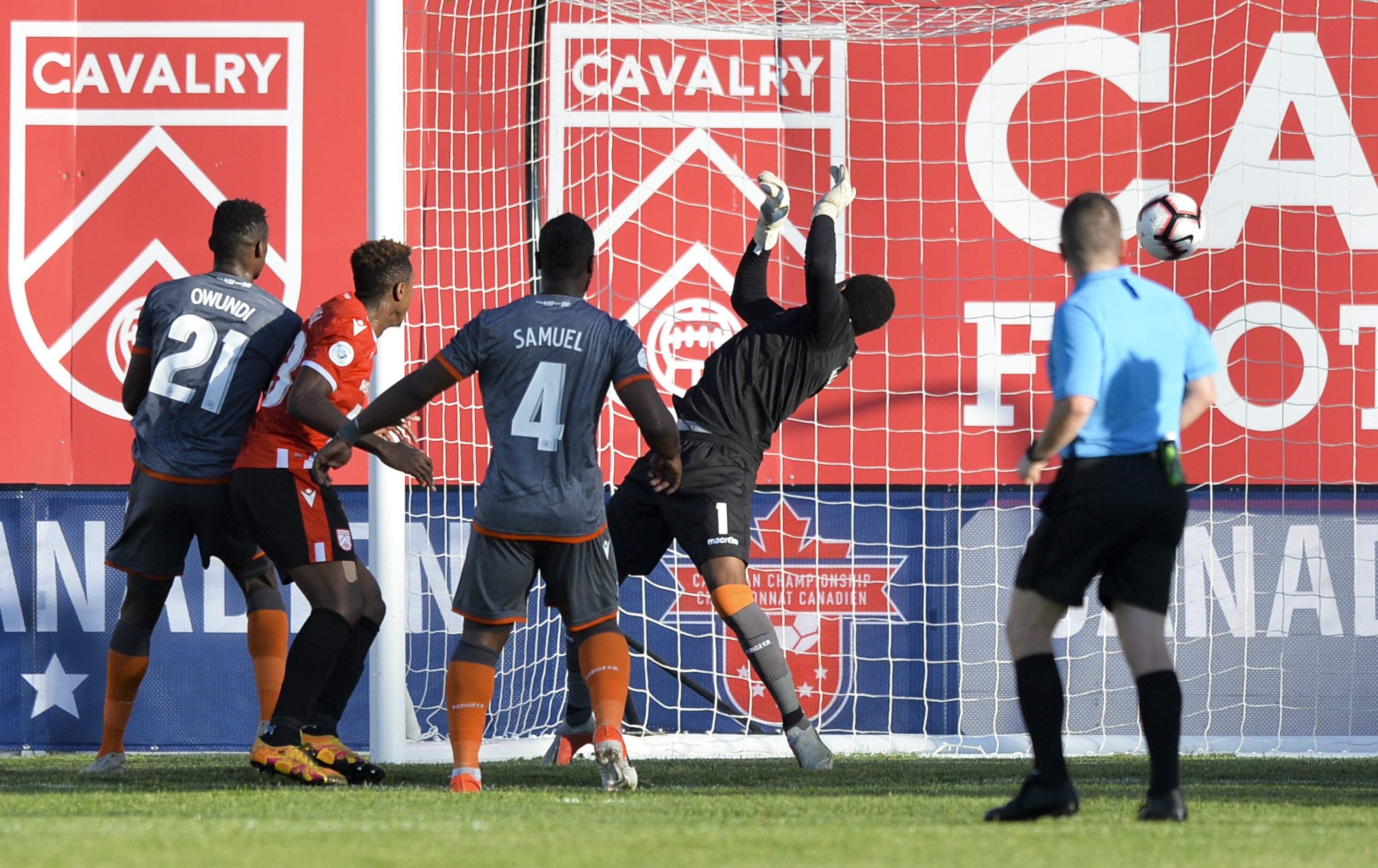 Dominique Malonga of Cavalry FC heads a goal past goalkeeper Triston Henry of Forge FC. (Mike Sturk/CPL).