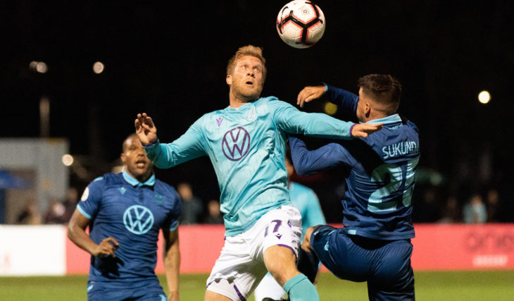 Pacific FC's Marcel de Jong challenging a ball against HFX Wanderers FC. (Photo: Scott Tanner).