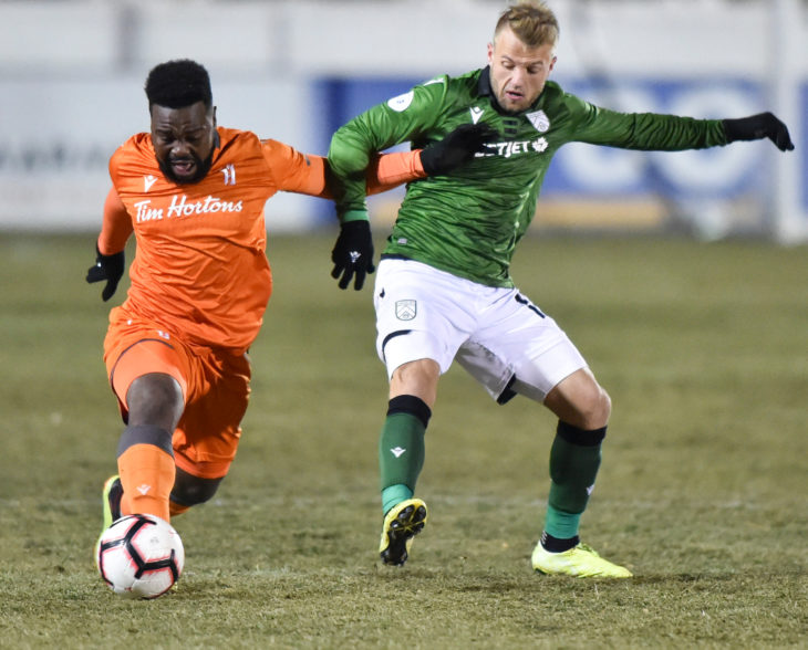 Dominic Samuel of Forge FC and Nico Pasquotti of Cavalry FC vie for the ball. Mike Sturk/CPL