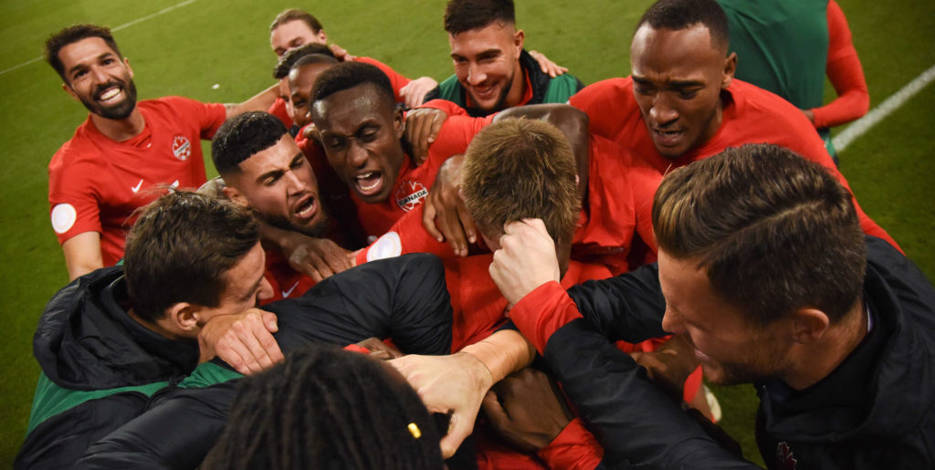 Alphonso Davies is mobbed by his teammates after scoring against the U.S. (Canada Soccer)