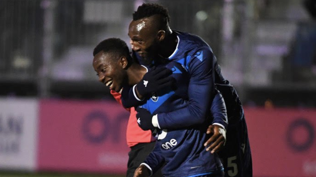 Prince Amanda (L) and Oumar Diouck (R) celebrate a goal against Pacific FC. (Photo: FC Edmonton).