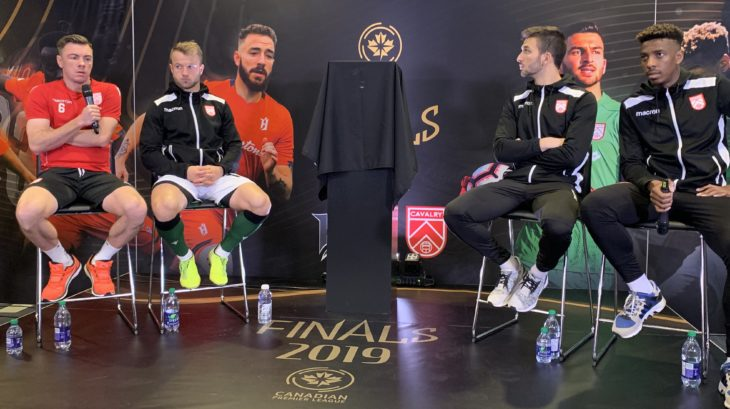 (L-R:) Nik Ledgerwood, Nico Pasquotti, Marco Carducci, and Dominique Malonga of Cavalry FC take questions on Media Day ahead of the 2019 Canadian Premier League Finals (Armen Bedakian/CPL)