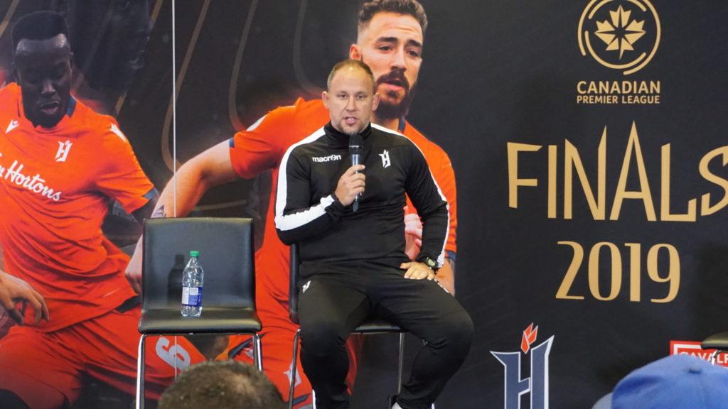 Forge FC head coach Bobby Smyrniotis addresses the media ahead of Leg 1. (Photo: Armen Bedakian).