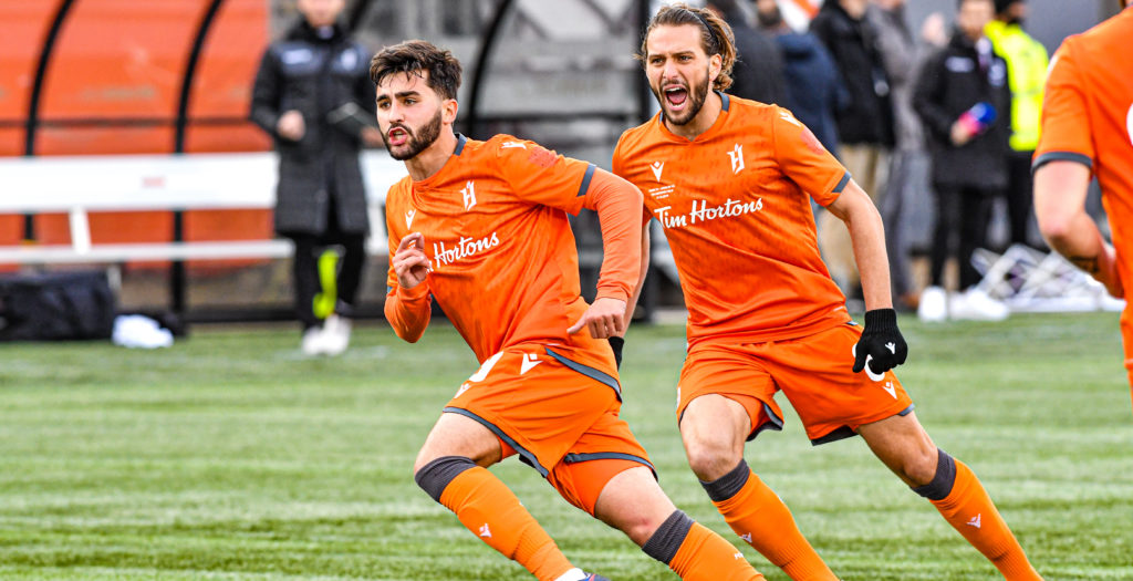 Forge FC's Tristan Borges, left, celebrates scoring against Cavalry FC on Saturday. (CPL)
