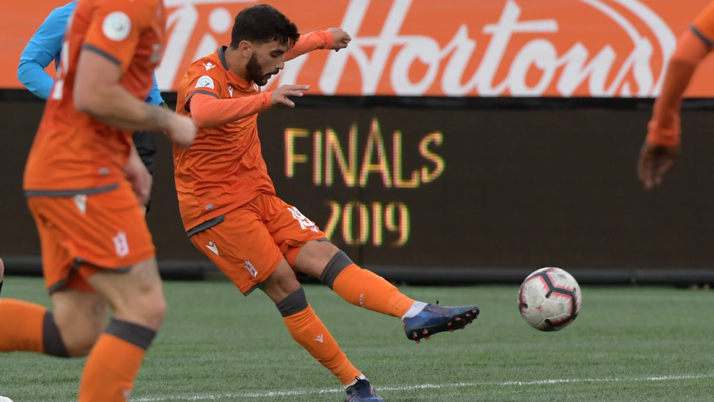 Oct 26, 2019; Hamilton, Ontario, CAN; Forge FC midfielder Tristan Borges (19) shoots to score a goal against Cavalry FC in the first half of a Canadian Premier League soccer final match at Tim Hortons Field. Mandatory Credit: Dan Hamilton-USA TODAY Sports for CPL