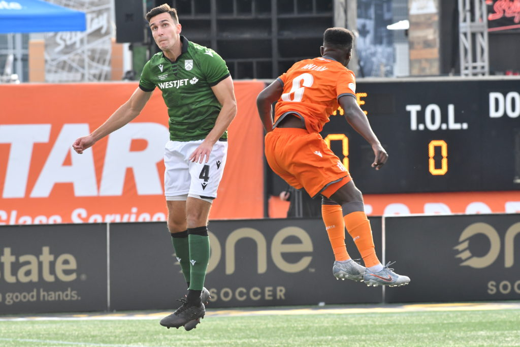 Cavalry's Dominick Zator and Forge's Kwame Awuah contend a ball during Leg 1 of Finals 2019. (Photo: CPL).