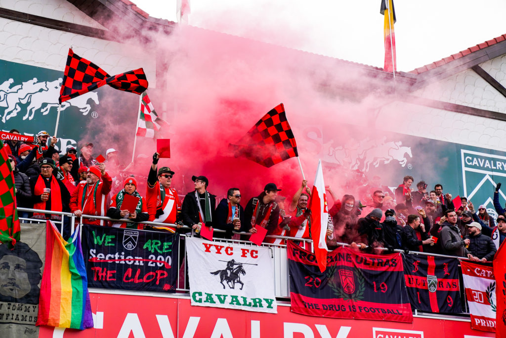 Cavalry FC supporters gear up for kickoff in Finals 2019 with some pyrotechnics. (Photo: CPL)