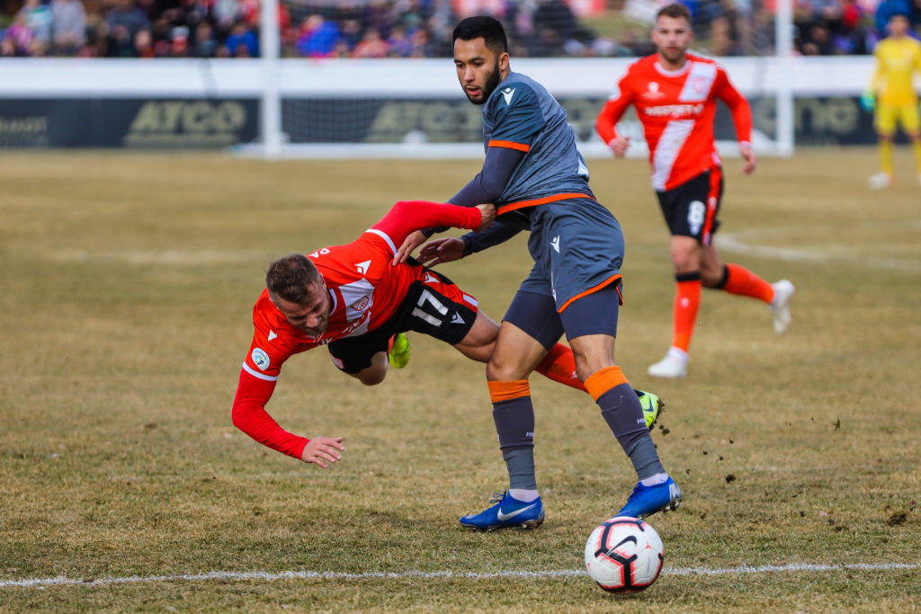 Forge FC midfielder David Choiniere (7) and Cavalry FC attacker Nico Pasquotti (17) battle for the ball in the second half during a Canadian Premier League soccer final match at Spruce Meadows. Mandatory Credit: Sergei Belski-USA TODAY Sports for CPL