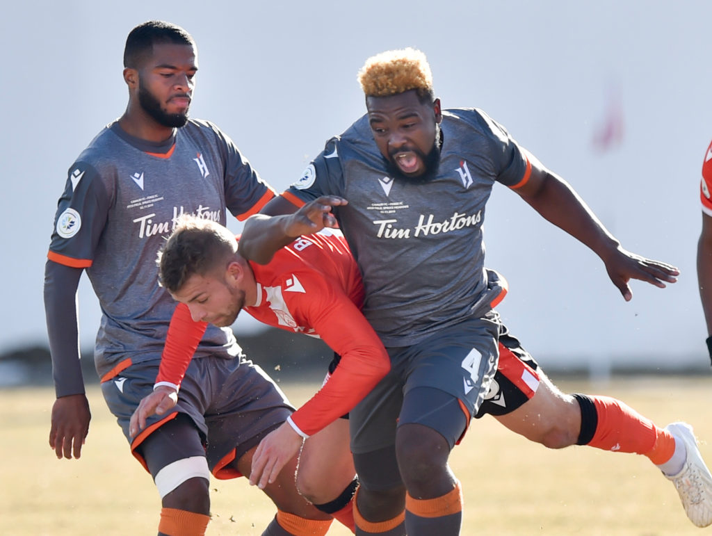 Canadian Premier League Finals - Cavalry FC v Hamilton Forge FC - Calgary, Alberta, Canada Nov. 2, 2019 Julian Buscher of Cavalry FC is sandwiched by Jonathan Grant (L) and Dominic Samuel of Forge FC. Mike Sturk/CPL