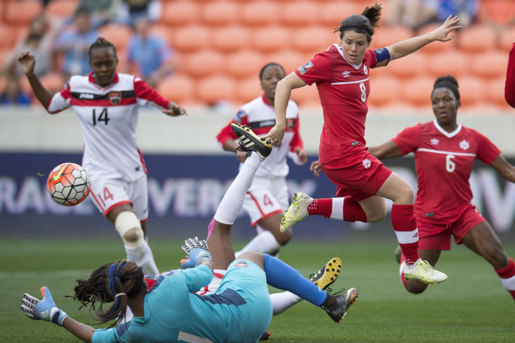 Diana Matheson scrambles for the ball against Trinidad and Tobago in 2016 CONCACAF Women's Olympic Qualifying. (Canada Soccer)