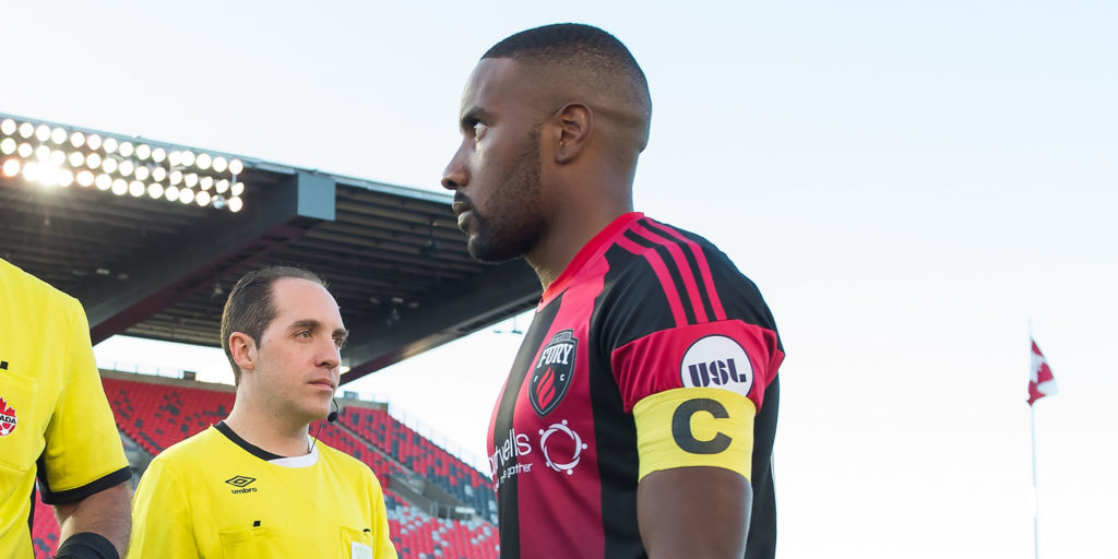 Canadian Championship 18 July 2017 - Ottawa, ON, CAN Canada Soccer by Steve Kingsman/Freestyle Photography Referee Silviu Petrescu with captains Jonathan Osorio and Jamar Dixon