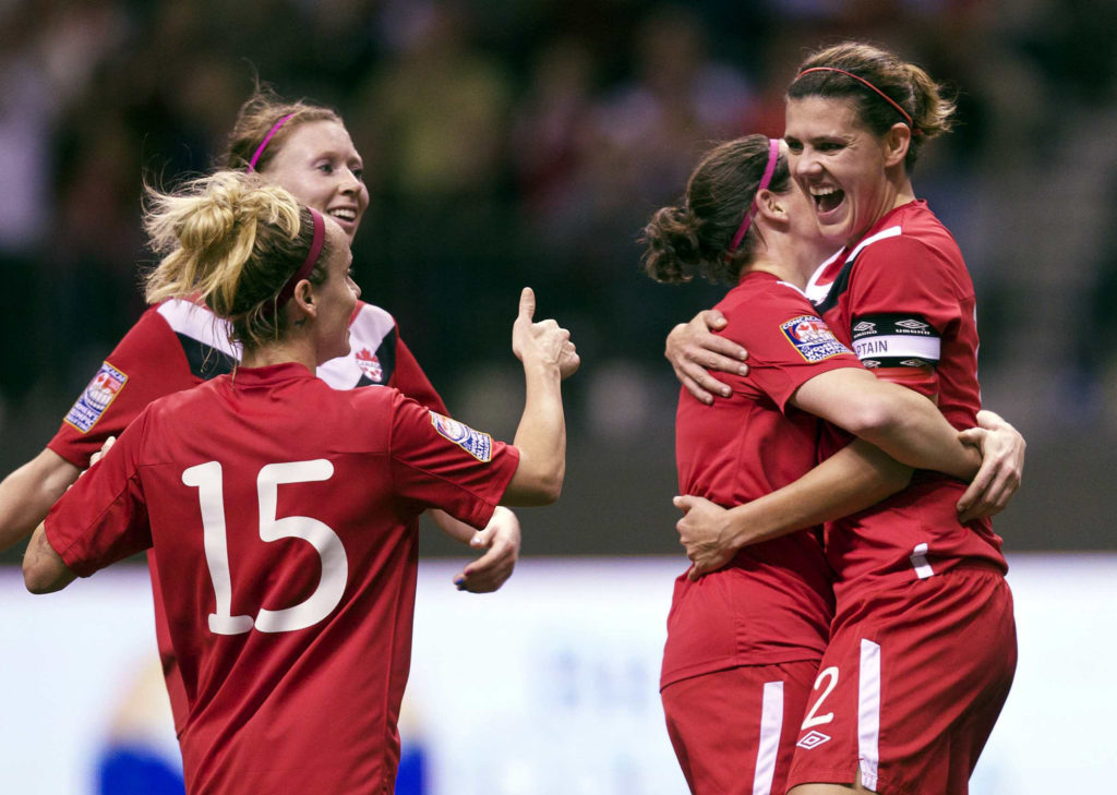 2012 CONCACAF Women's Olympic Qualifying Canada Soccer / Mexsport Stephen Brashear 23 January 2012 - BC Place in Vancouver, BC Christine Sinclair goal celebration (Kelly Parker, Melanie Booth and Rhian Wilkinson)