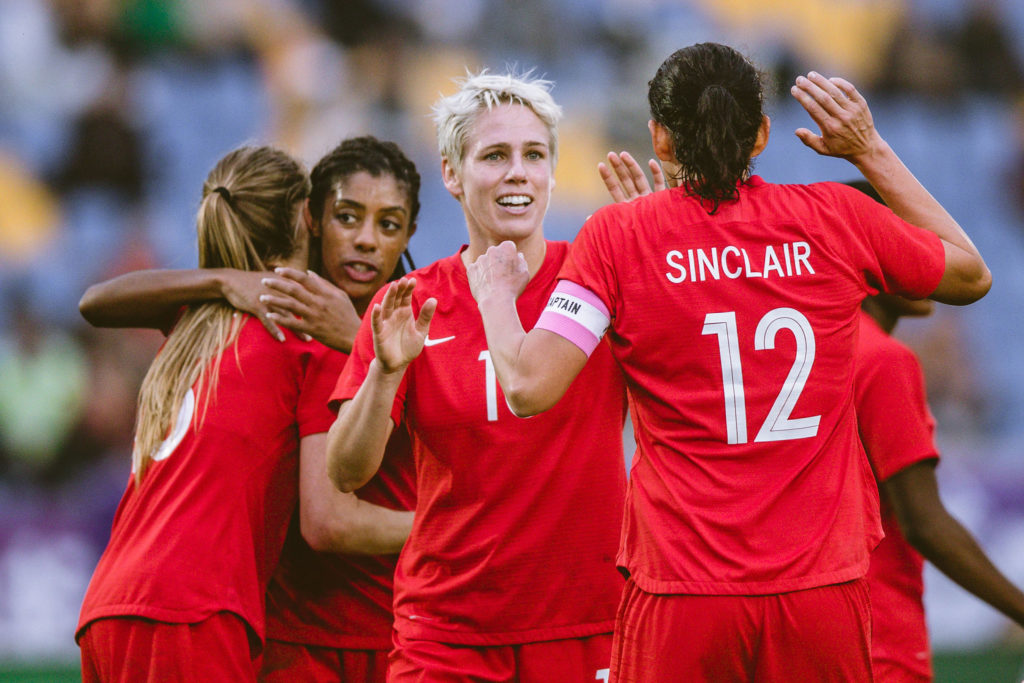 Sophie Schmidt and Christine Sinclair celebrate. (Photo: Canada Soccer).