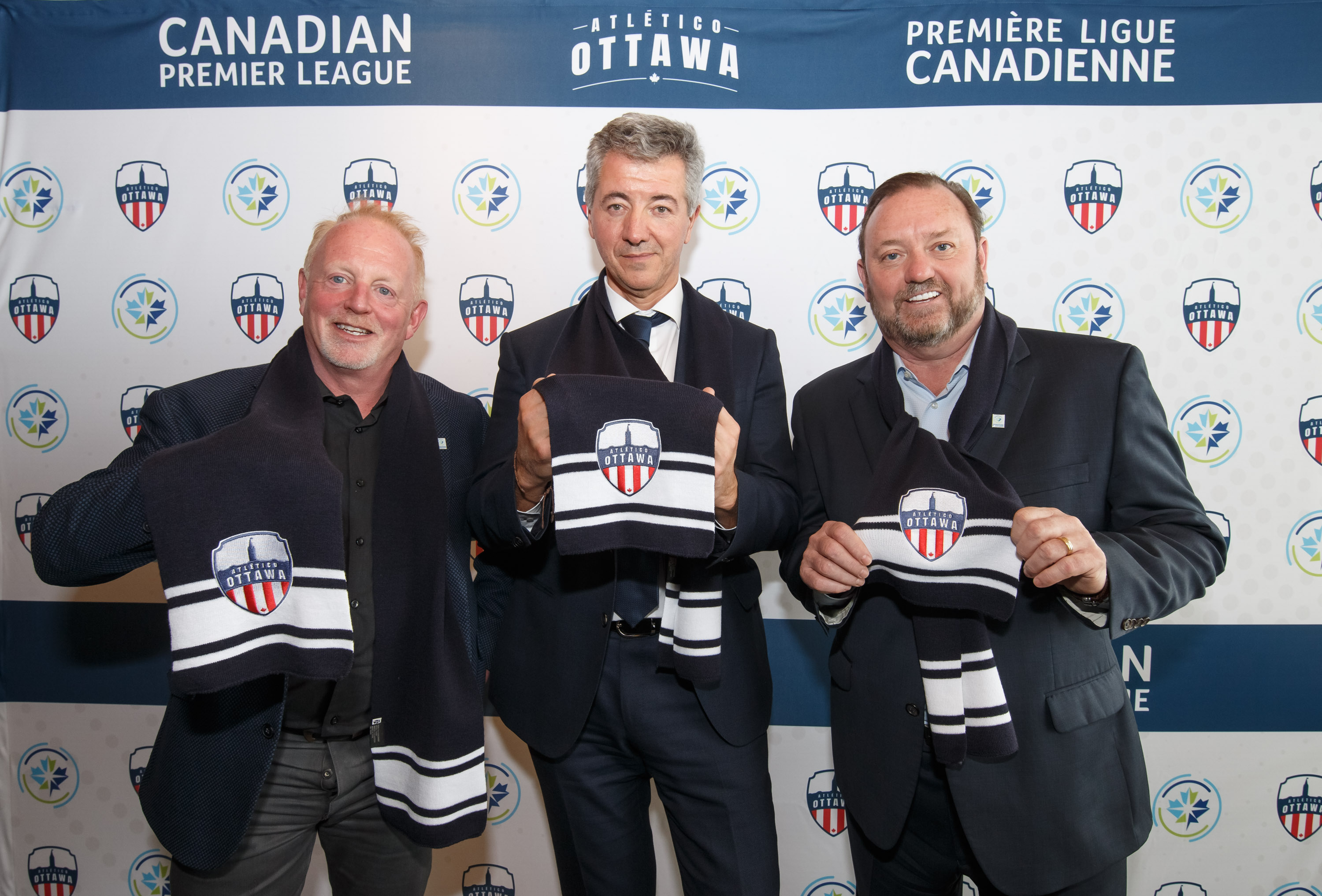 Atlético Ottawa strategic partner Jeff Hunt, Canadian Premier League commissioner David Clanachan and Club Atlético de Madrid CEO Miguel Ángel Gil Marín. (CPL).