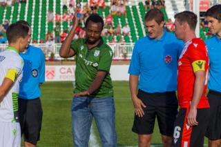 Jean-Claude Munyezamu doing the official coin toss for the match.