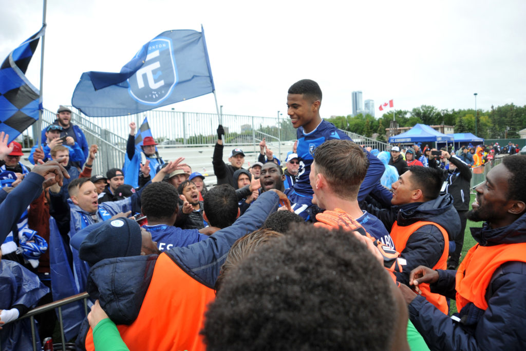 Jul 1, 2019; Edmonton, Alberta, CAN; FC Edmonton forward Marcus Velado-Tsegaye (17) his held up by his fellow players as they celebrate their win and his birthday with the fans on HFX Wanderers FC at the end of the second half of a Canadian Championship soccer match at Clarke Field. Edmonton won the game 2-0. Mandatory Credit: Walter Tychnowicz-USA TODAY Sports for CPL