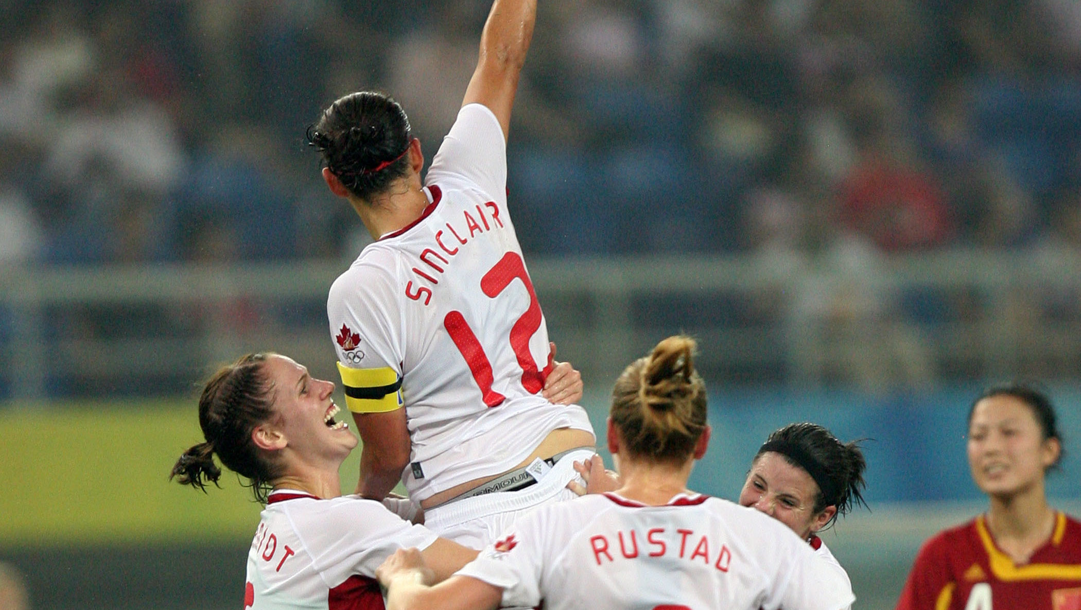 Christine Sinclair #12 of Canada has just scored during a 2008 Olympic Games match against China at TJ Olympic Centre Stadium on August 9 2008, in Tianjin China. The match ended in a 1-1 tie.