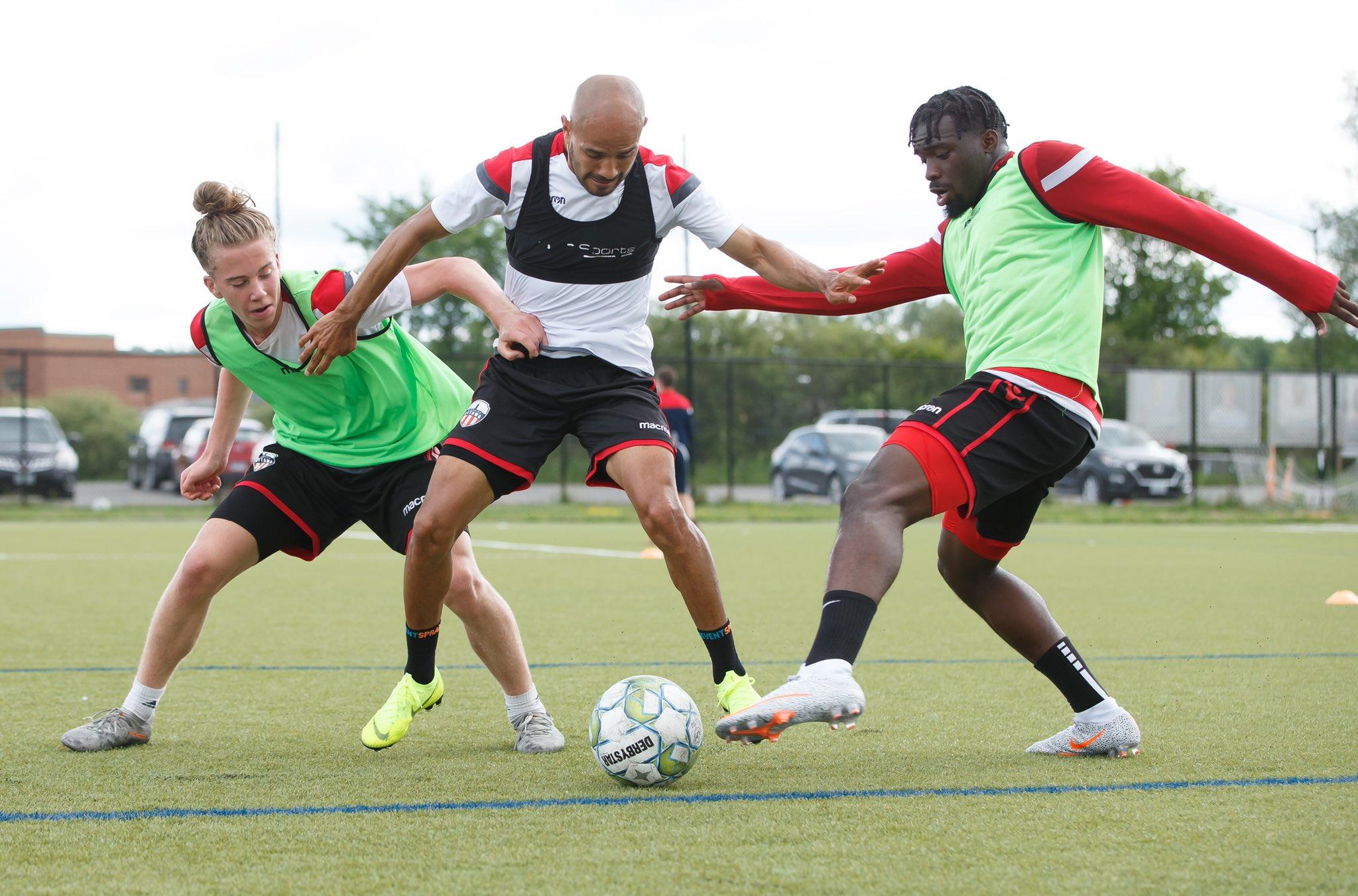 Atlético Ottawa's Antoine Coupland, Francisco Acuña, and Kunle Dada-Luke battle for possession. (Atlético Ottawa)