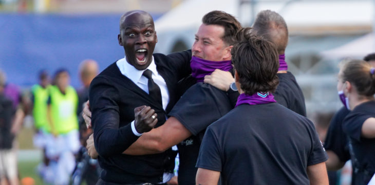 Pacific FC coach Pa-Modou Kah celebrates a goal vs. HFX Wanderers with his staff. (Photo: CPL / Chant Photography)