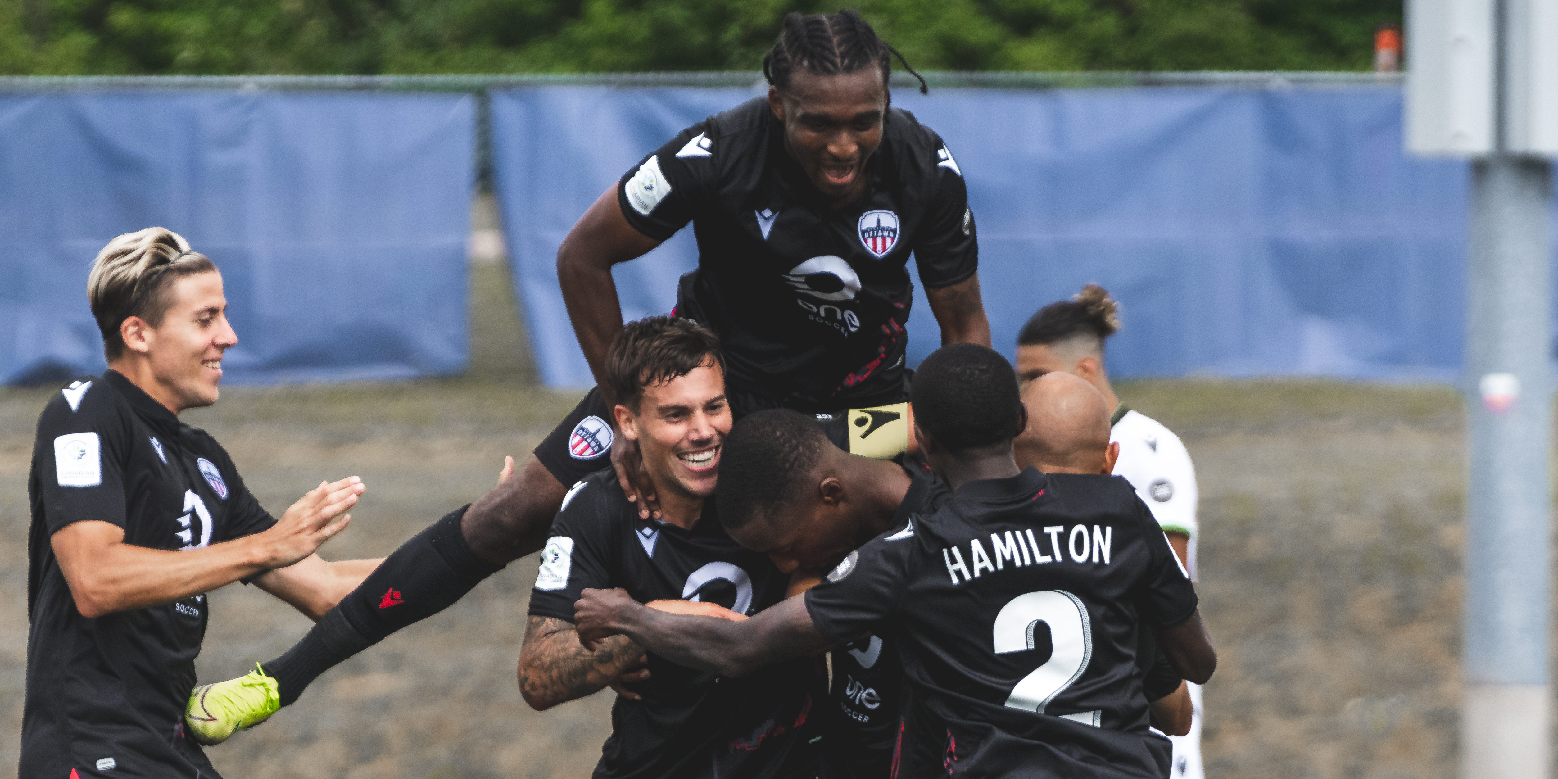 Atlético Ottawa players celebrate a goal against York9 FC. (Photo: CPL / Chant Photography)