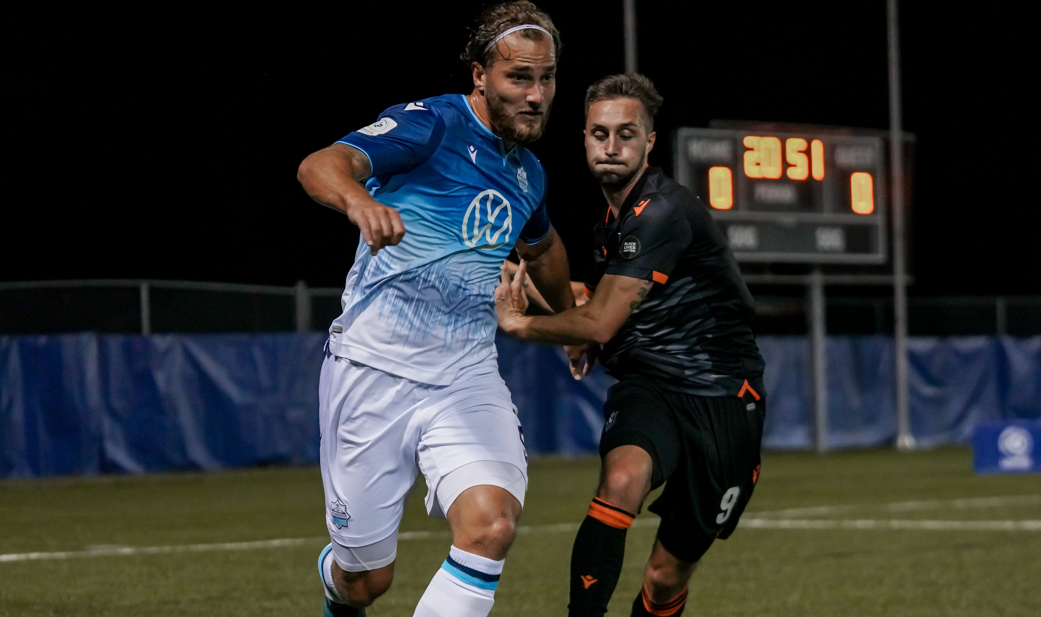 HFX Wanderers defender Peter Schaale and Forge FC attacker Marcel Zajac. (CPL/Chant Photography)