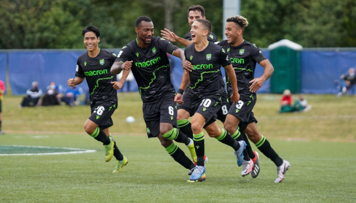 Many Aparicio (no. 10) celebrates with his York9 FC teammates after scoring against HFX Wanderers FC. (CPL/Chant Photography)