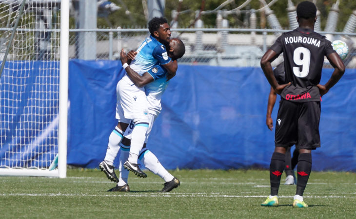 Akeem Garcia and an HFX Wanderers teammate celebrate his goal against Atlético Ottawa. (CPL/Chant Photography)