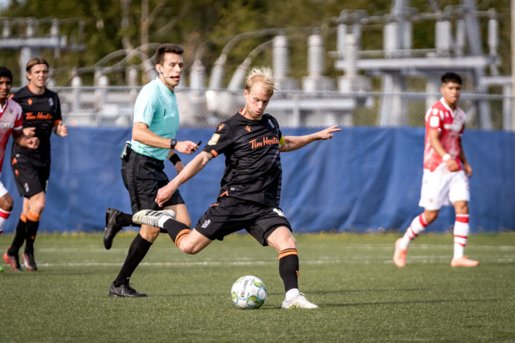 Forge FC captain Kyle Bekker plays the ball vs. Cavalry FC. (Photo: CPL/Chant Photography)