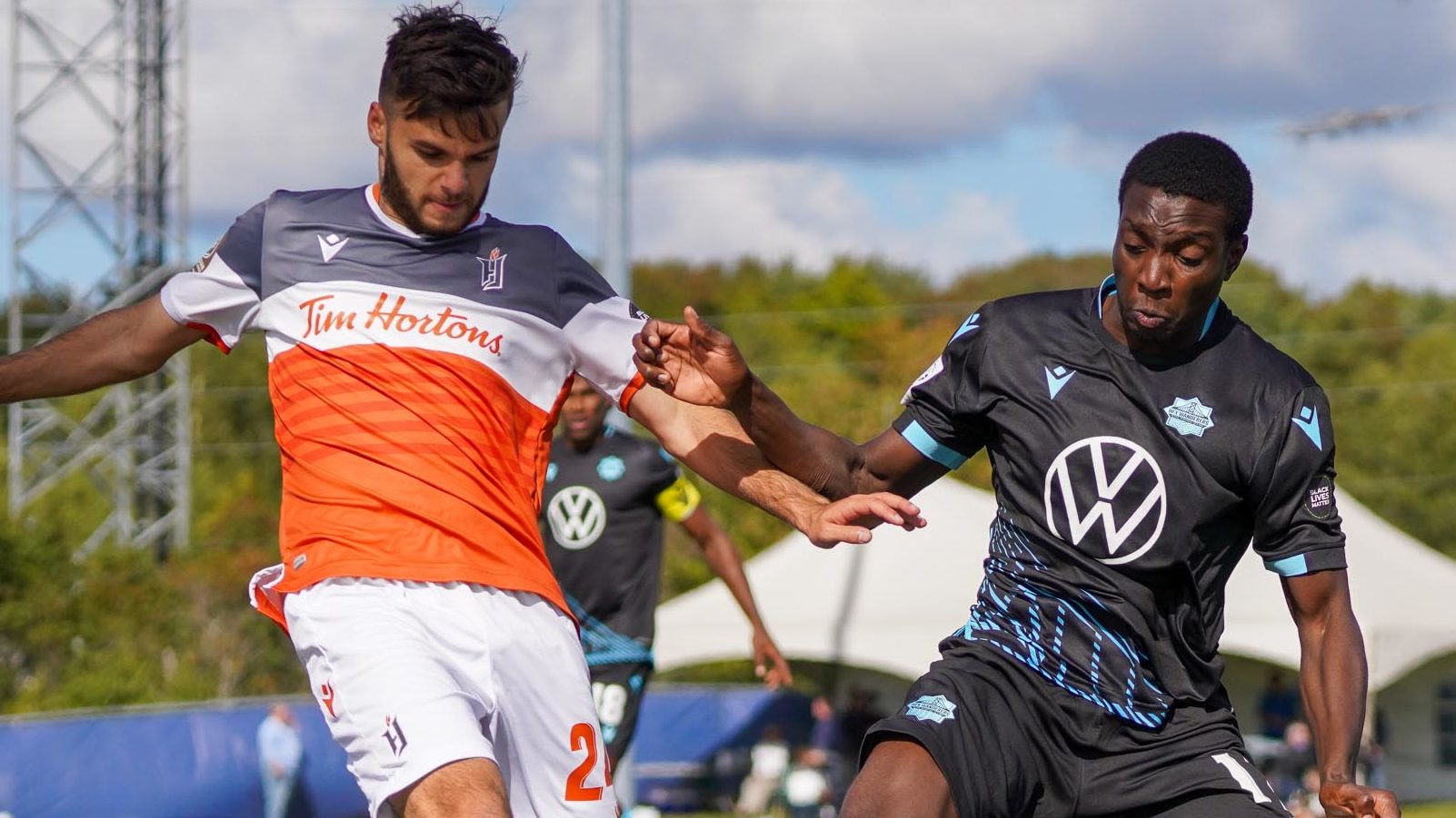 HFX Wanderers midfielder Abou Sissoko challenges Forge FC's Paolo Sabak. (CPL/Chant Photography)