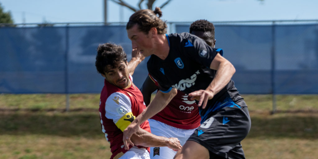 FC Edmonton's Easton Ongaro battles with Jose Galan of Valour FC. (Photo: CPL/Chant Photography)