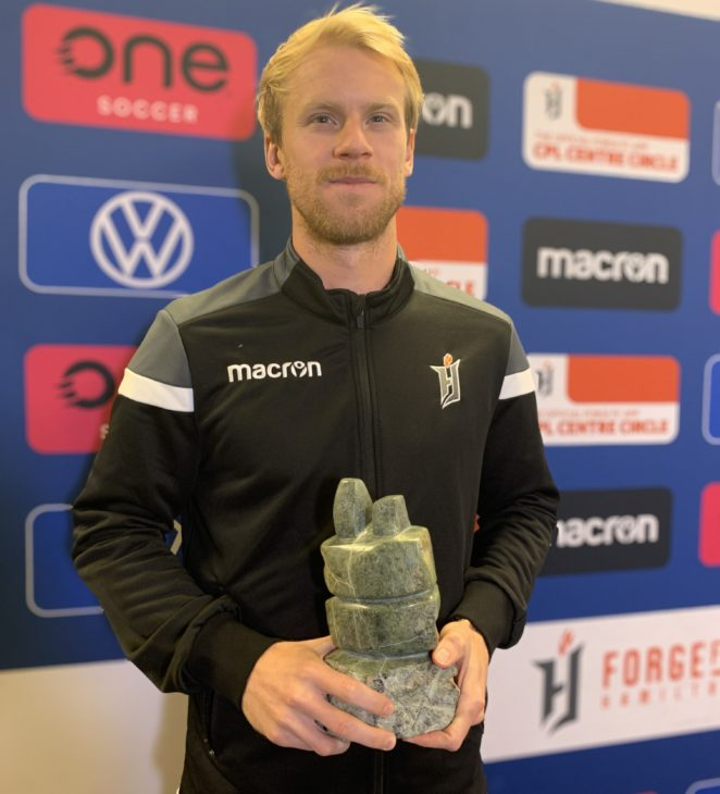 Forge FC's Kyle Bekker with the 2020 CPL Player of the Year award. (CPL photo)