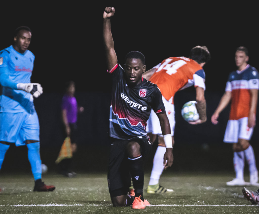 Cavalry FC's Nathan Mavila kneels in support of the Black Lives Matter movement after scoring vs. Forge FC. (Photo: CPL/Chant Photography)