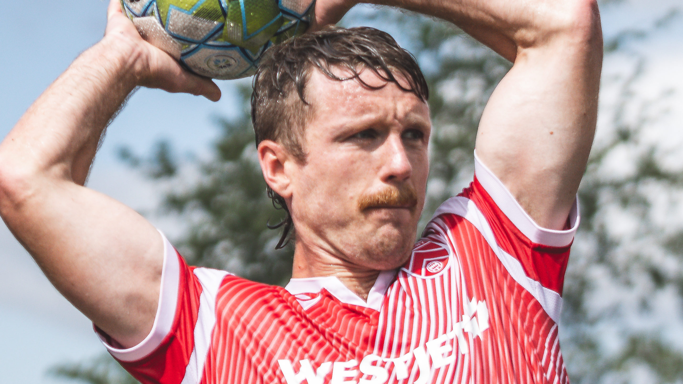Dean Northover showed up to The Island Games with a killer mullet-mustache combo. (Photo: CPL/Chant Photography)