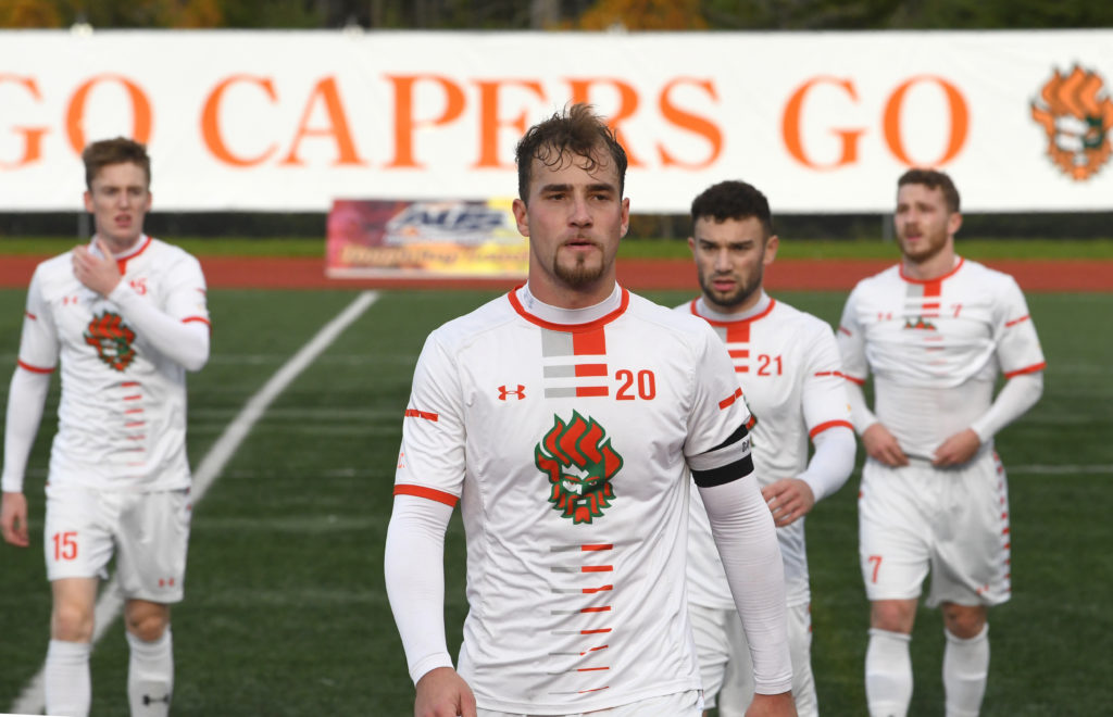 Cape Breton University players, including Peter Schaale (no. 20) and Marcus Campanile (no. 21). (Photo: Vaughan Merchant)