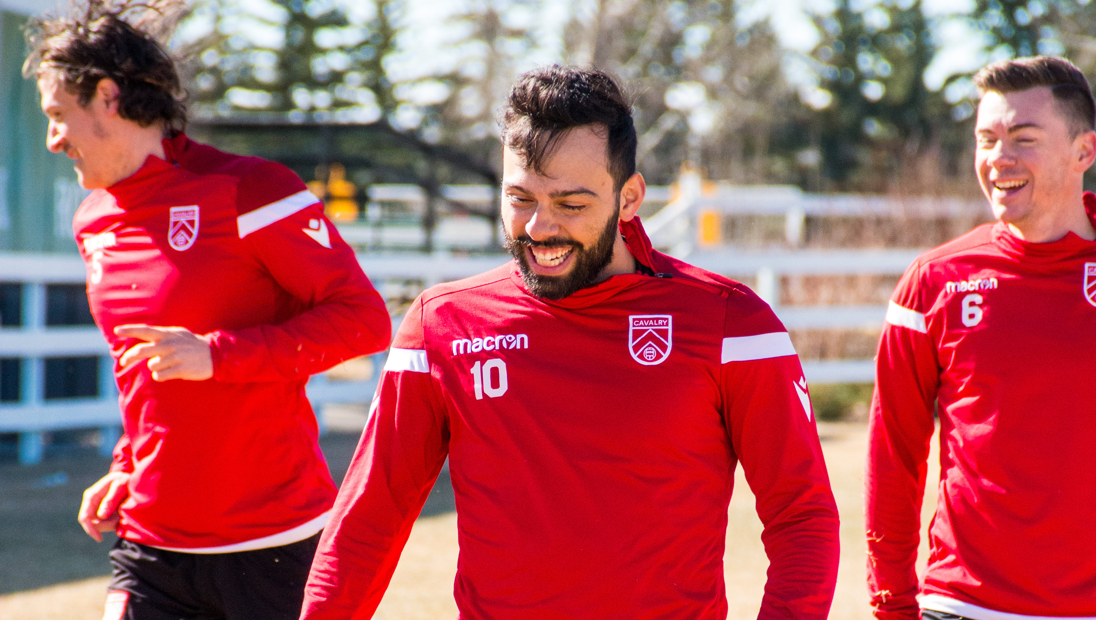 All smiles from Cavalry FC's (left to right) Mason Trafford, Sergio Camagro, and Nik Ledgerwood. (Cavalry FC)