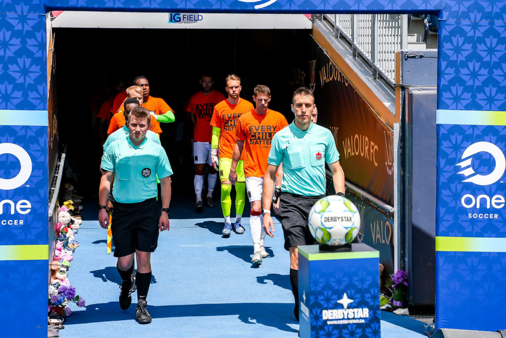 Forge FC and Valour FC players head to the pitch (Photo: Canadian Premier League / Robert Reyes/William Ludwick)