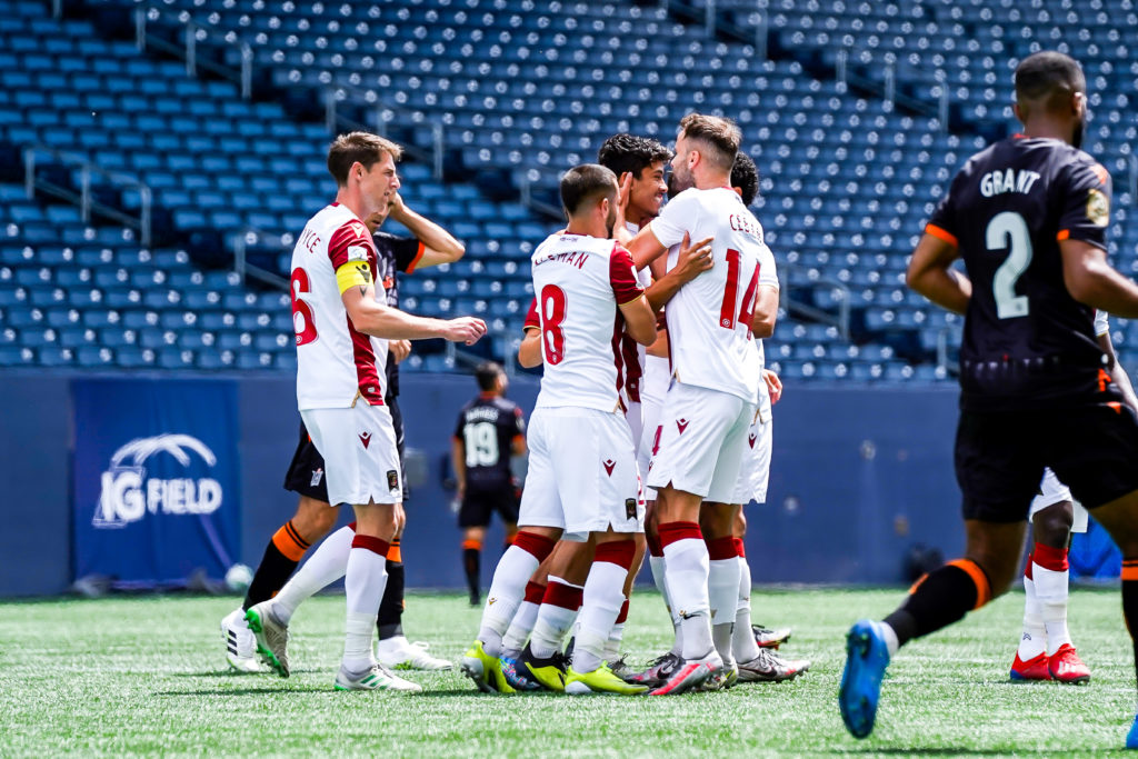 Valour FC players celebrate a goal by Moses Dyer on a penalty kick. (Photo: Canadian Premier League / Robert Reyes/William Ludwick)