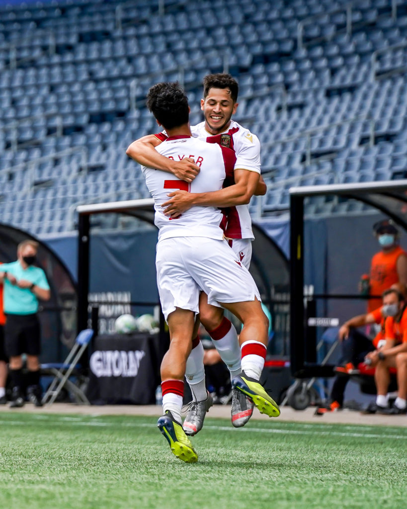 Austin Ricci and Moses Dyer celebrate after Ricci's first half-goal against Forge FC (Photo: Canadian Premier League / Robert Reyes/William Ludwick)