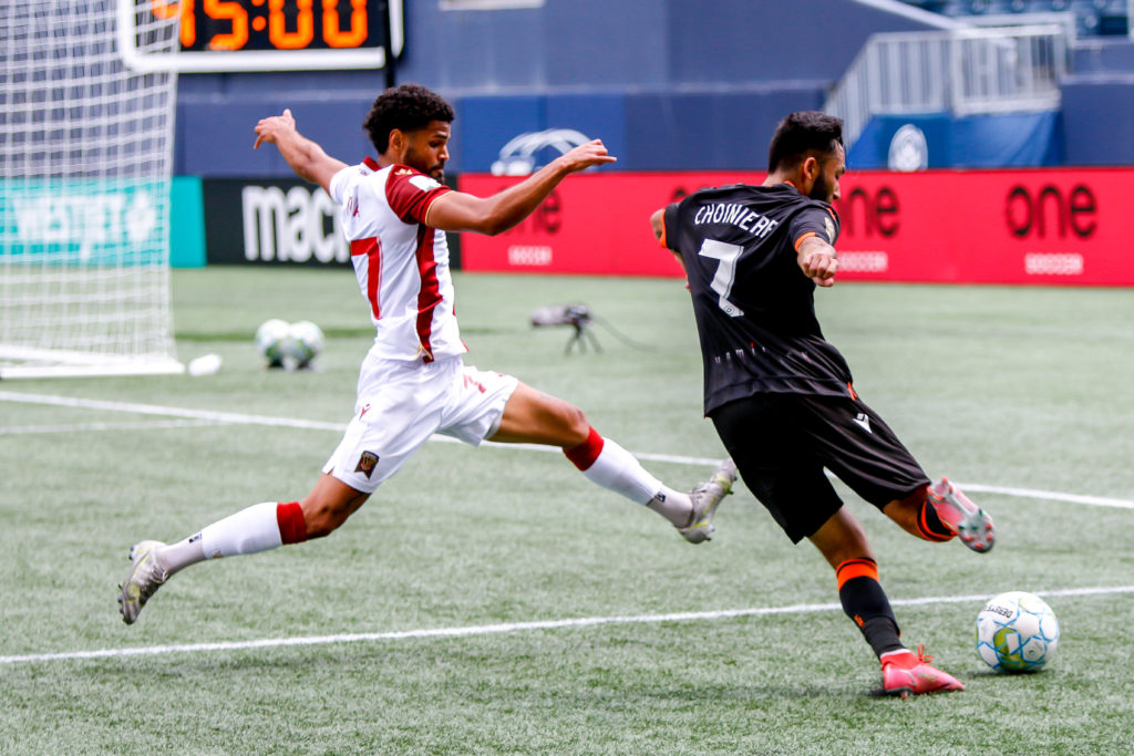 Forge's David Choinière plays the ball as Valour's Federico Peña defends (Photo: Canadian Premier League / Robert Reyes/William Ludwick)