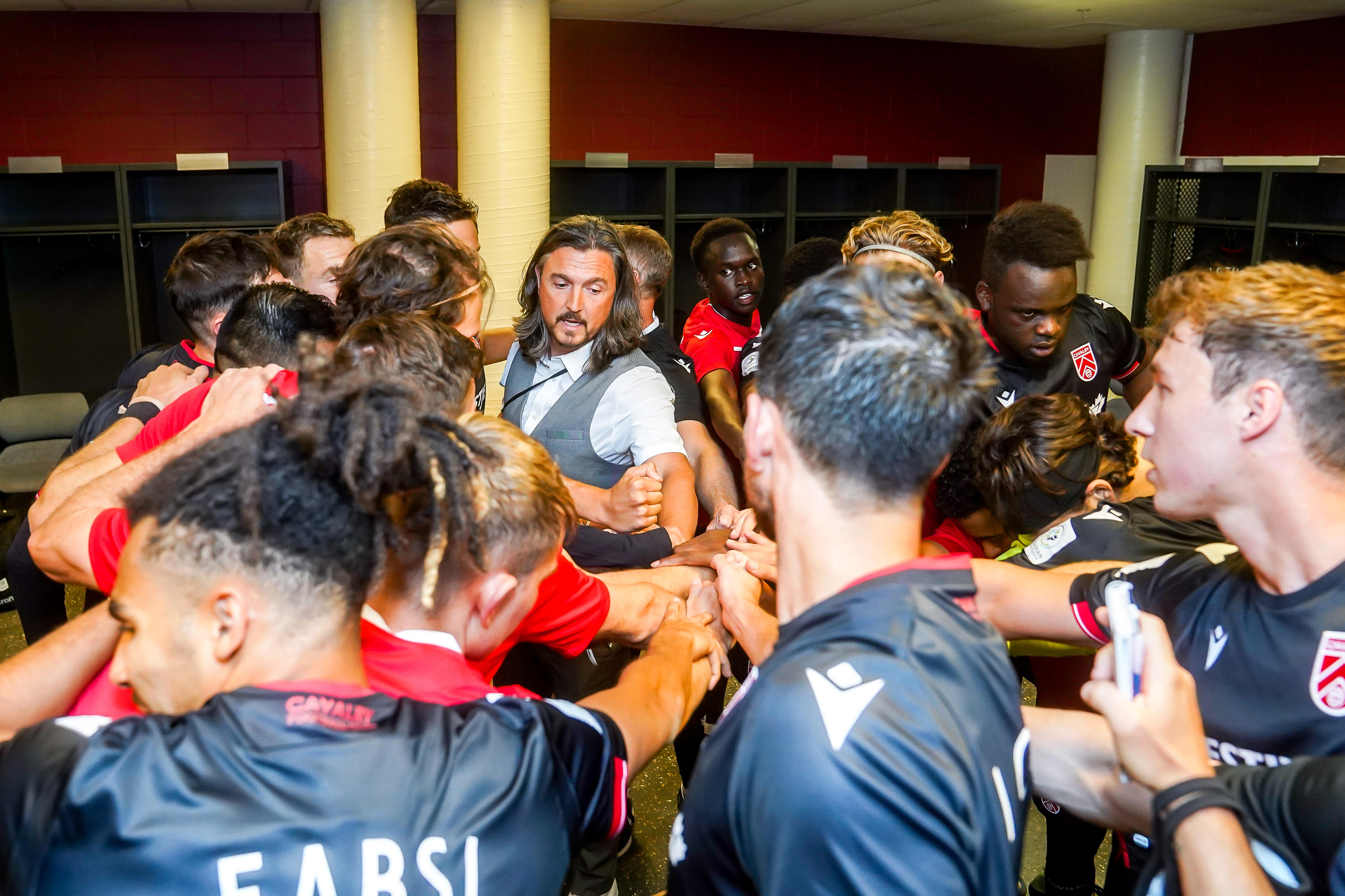 Head Coach Tommy Wheeldon Jr. leads the team huddle. (CPL)