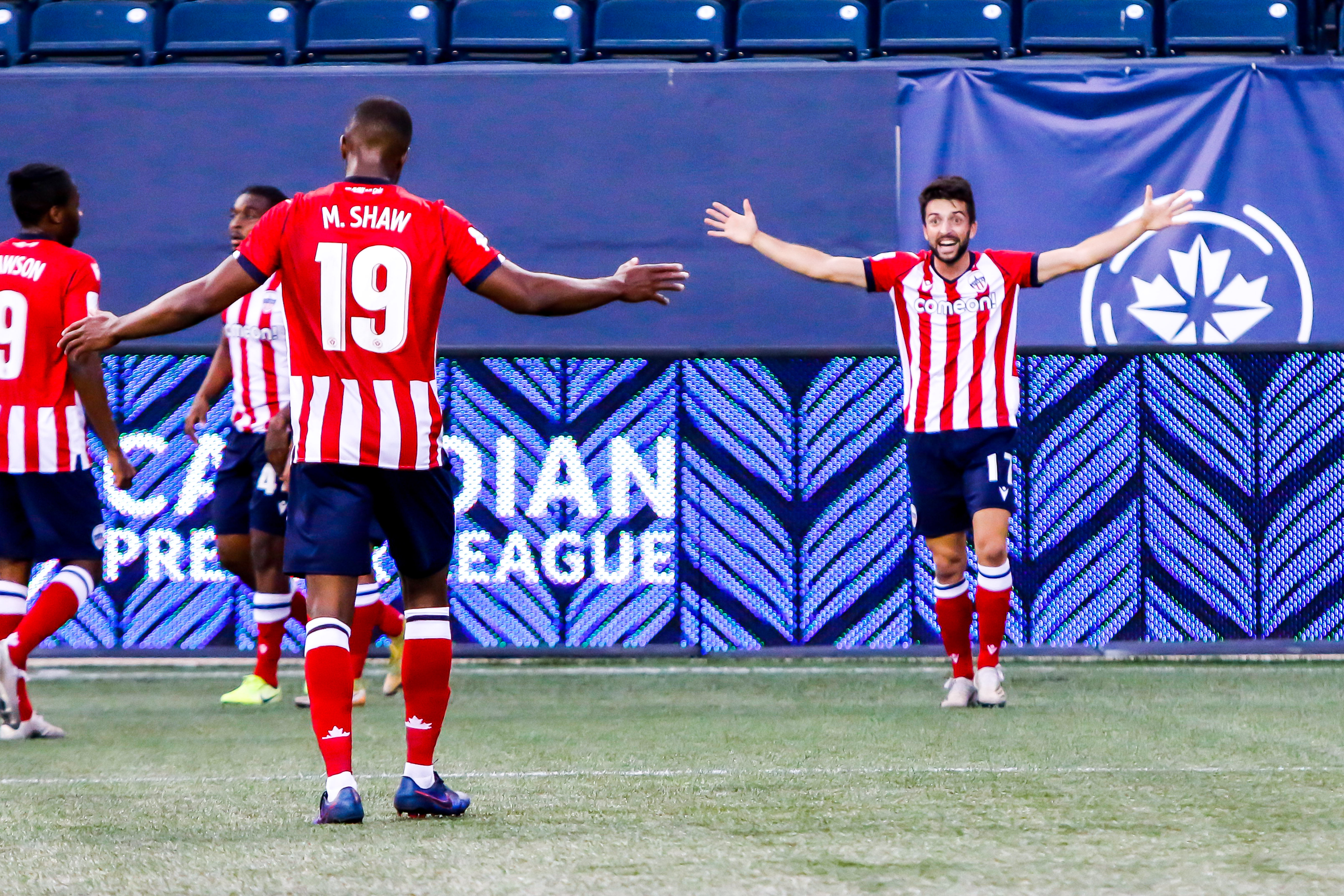 June 30, 2021. Atlético Ottawa vs. Cavalry FC. First-Half. Miguel Acosta celebrates his first half goal with teammate Malcolm Shaw
