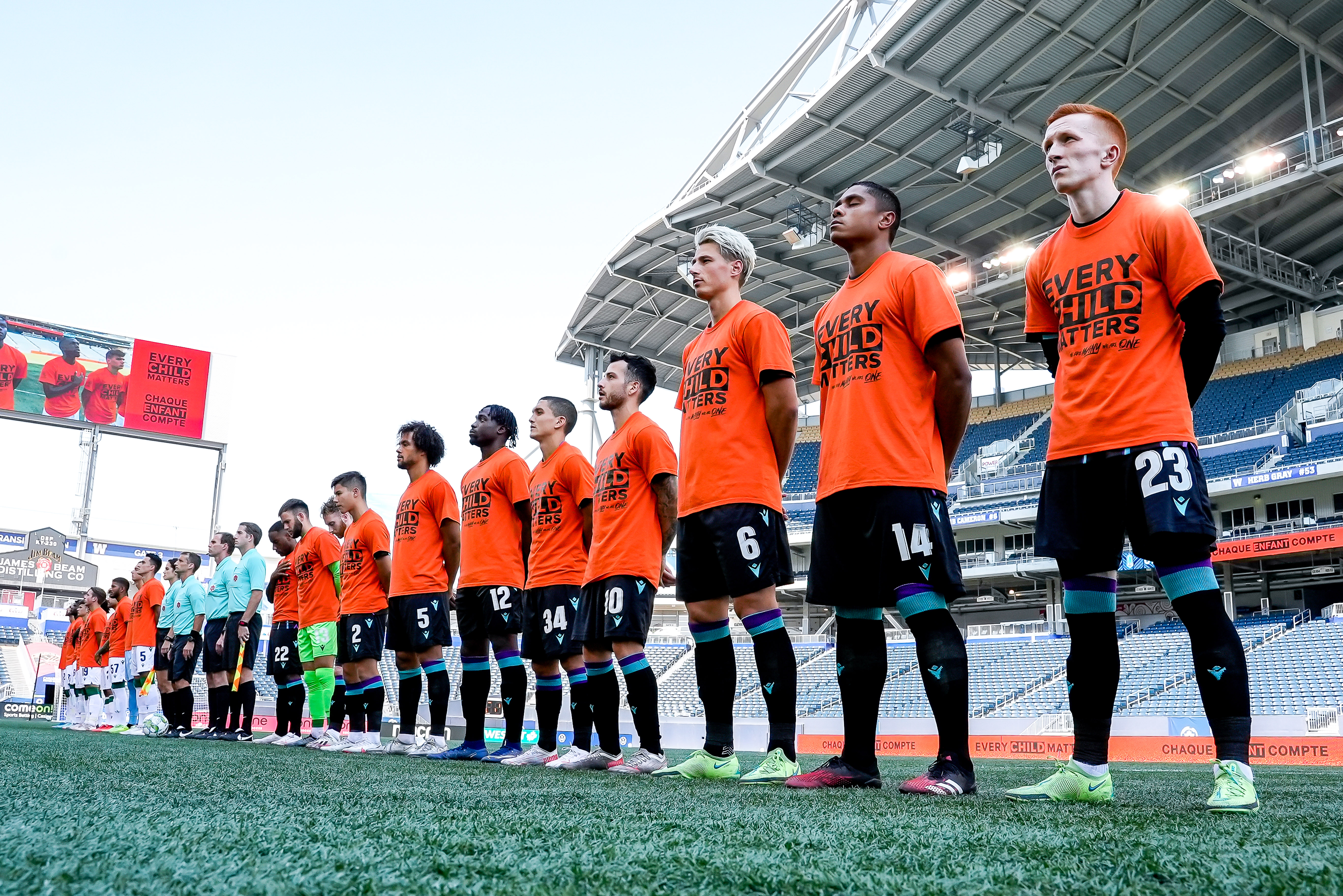 Pacific FC players stand during the playing of 'O Canada'. (CPL)