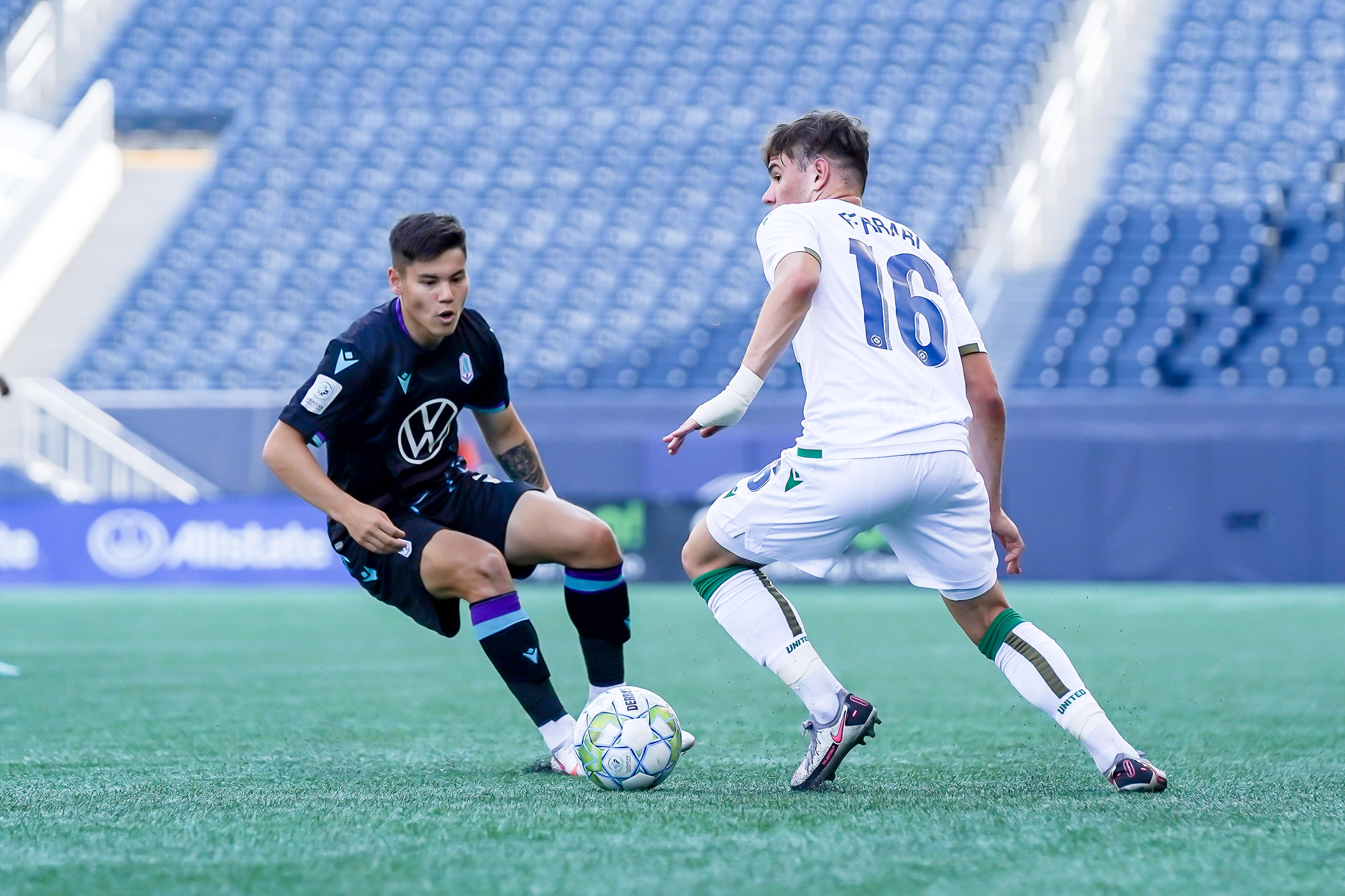 Max Ferrari plays the ball as Kadin Chung defends. (CPL)