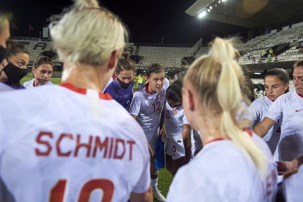 Christine Sinclair leads a Canada huddle (Photo: Canada Soccer by Gerard Franco)