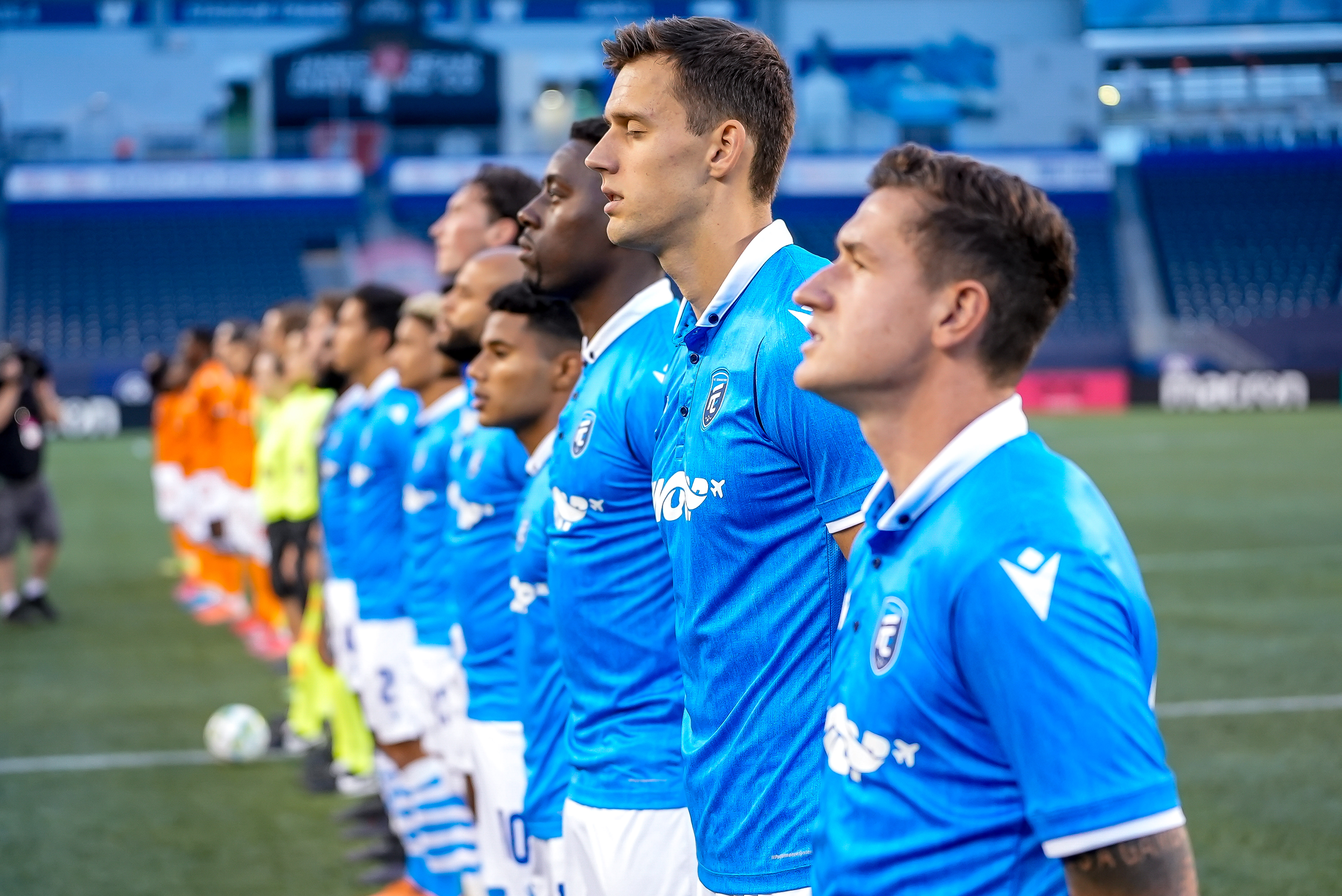 July 14, 2021. Forge FC vs FC Edmonton. Pre-Game. FC Edmonton players stand for the playing of 'O Canada'.