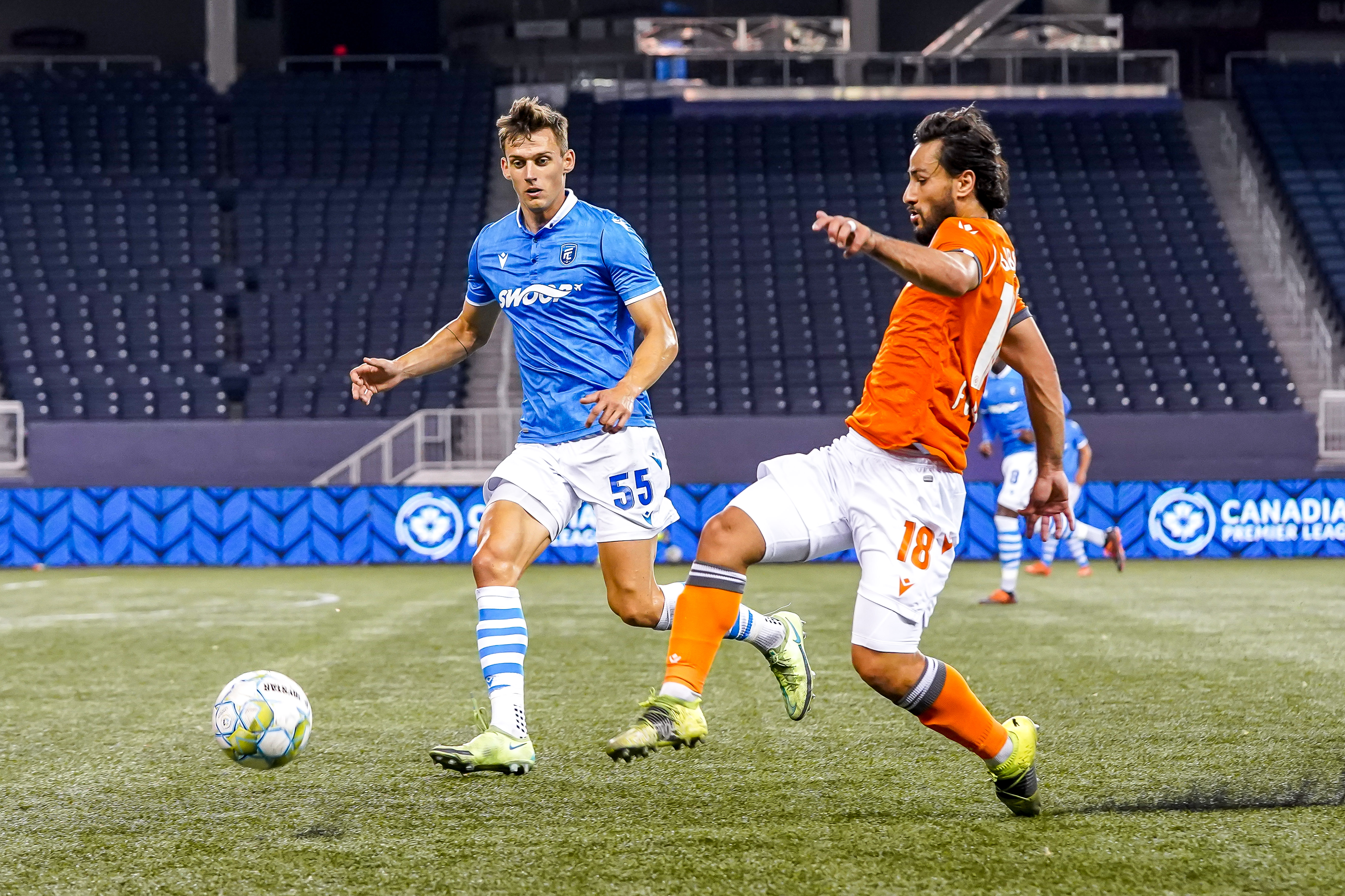 July 14, 2021. Forge FC vs FC Edmonton. Second-Half. Amer Didic of FC Edmonton and Molham Babouli of Forge FC chase the loose ball.