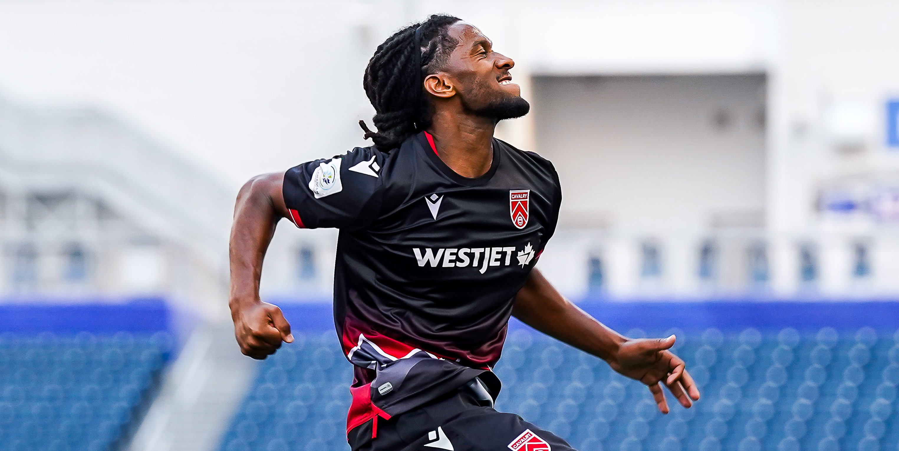 July 17, 2021. HFX Wanderers FC vs Cavalry FC. Second-Half. Ali Musse of Cavalry FC jumps in joy as he celebrates his goal against HFX Wanderers FC as teammate Anthony Novak looks on. (CPL)